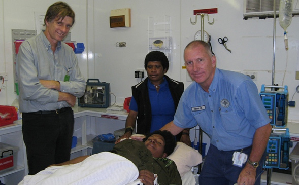 Dr-Dent-and-Michael-Conlon-assisting-at-Juni-Clinic-PNG-1999